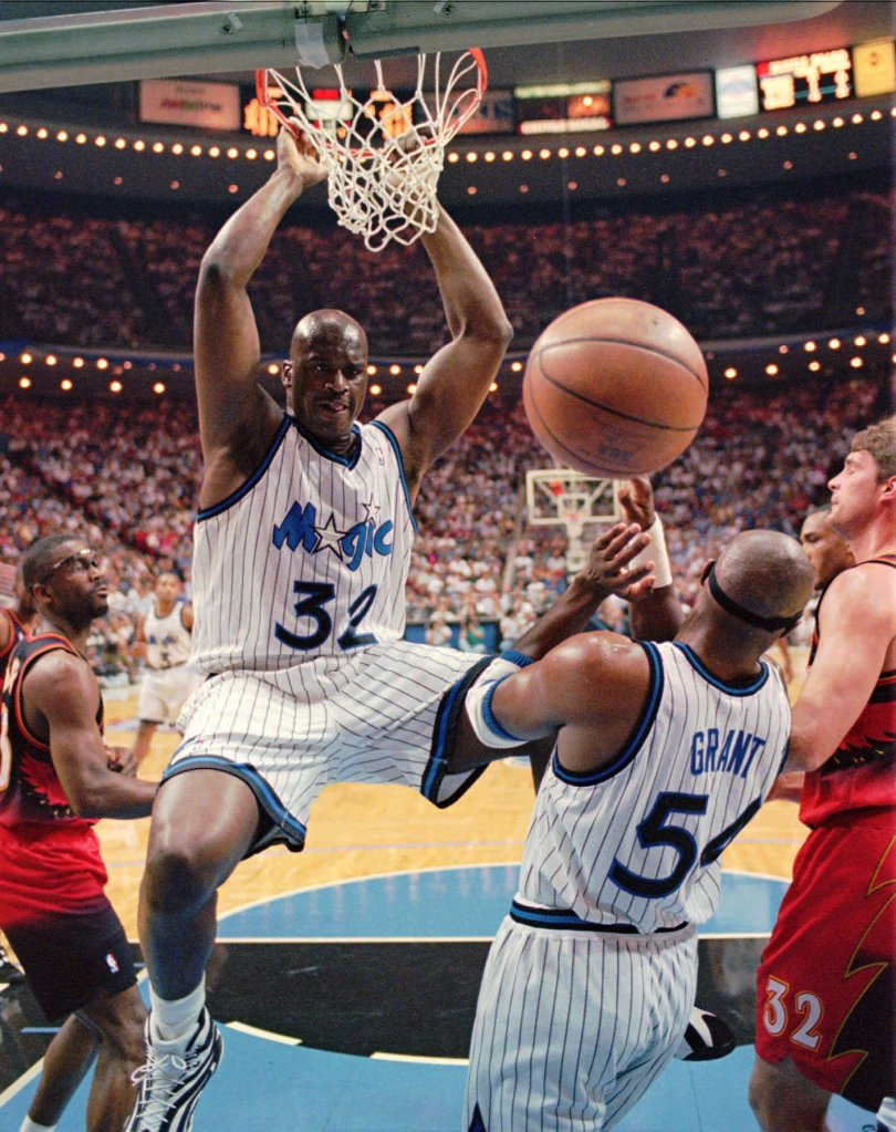 O''NEAL GRANT LONG LAETTNER Orlando Magic center Shaquille O'Neal (32) hangs onto the rim after a powerful slam dunk during the first quarter fo their Eastern Conference Semifinal game against the Atlanta Hawks Wednesday night . Defending on the play is Hawks Grant Long (43), left, Horace Grant (54) and Christian Laettner (32), rightHAWKS MAGIC, ORLANDO, USA
