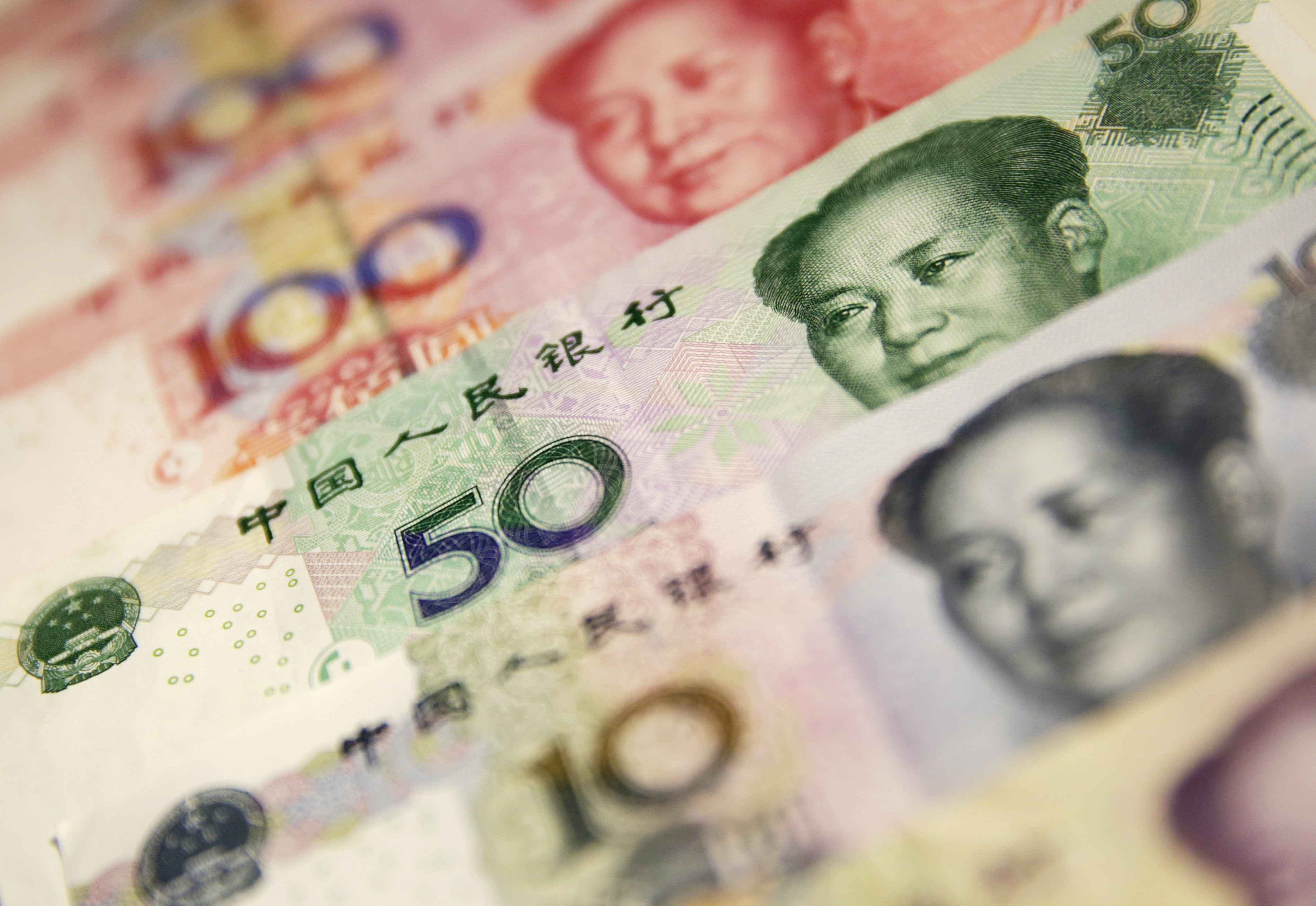 Chinese Yuan Or Renminbi (rmb) Notes in Beijing China 29 December 2015 China's Currency Fell to Its Weakest in More Than Four and a Half Years on 29 December 2015 the Yuan Also Known As the Renminbi Dropped 114 Basis Points to 6 4864 Against the Us Dollar on 29 December Its Weakest Since June 2011 According to Data From the China Foreign Exchange Trading System China BeijingChina Currency - Dec 2015