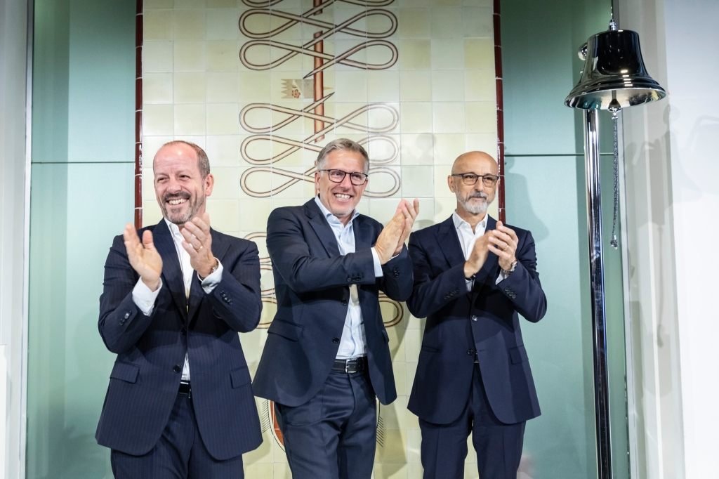 From left: Franco Martorella, Luca Sburlati and Fulvio Botto after ringing the bell of the market opening ceremony at Palazzo Mezzanotte, Milan.