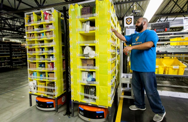An employee picking with Amazon robotics.