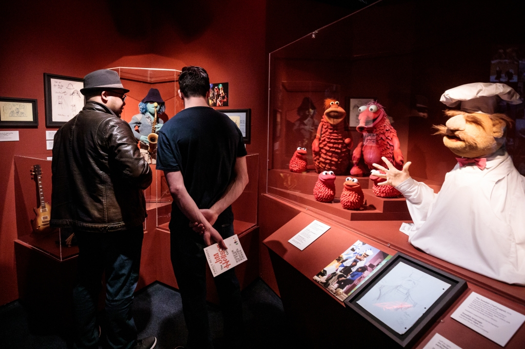 During MoMI Free Friday Nights, visitors in The Jim Henson Exhibition at Museum of the Moving Image. Puppets shown (from left): Zoot, Koozebanians, the Swedish Chef. Photo: Sachyn Mital / MoMI (February 2019)