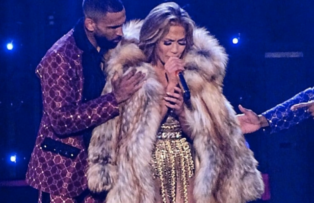 """Jennifer Lopez performs in New York on July 19, donning a floor-length fur designed at Saks Fifth Avenue's Fur Salon for her """"It's My Party"""" tour."""