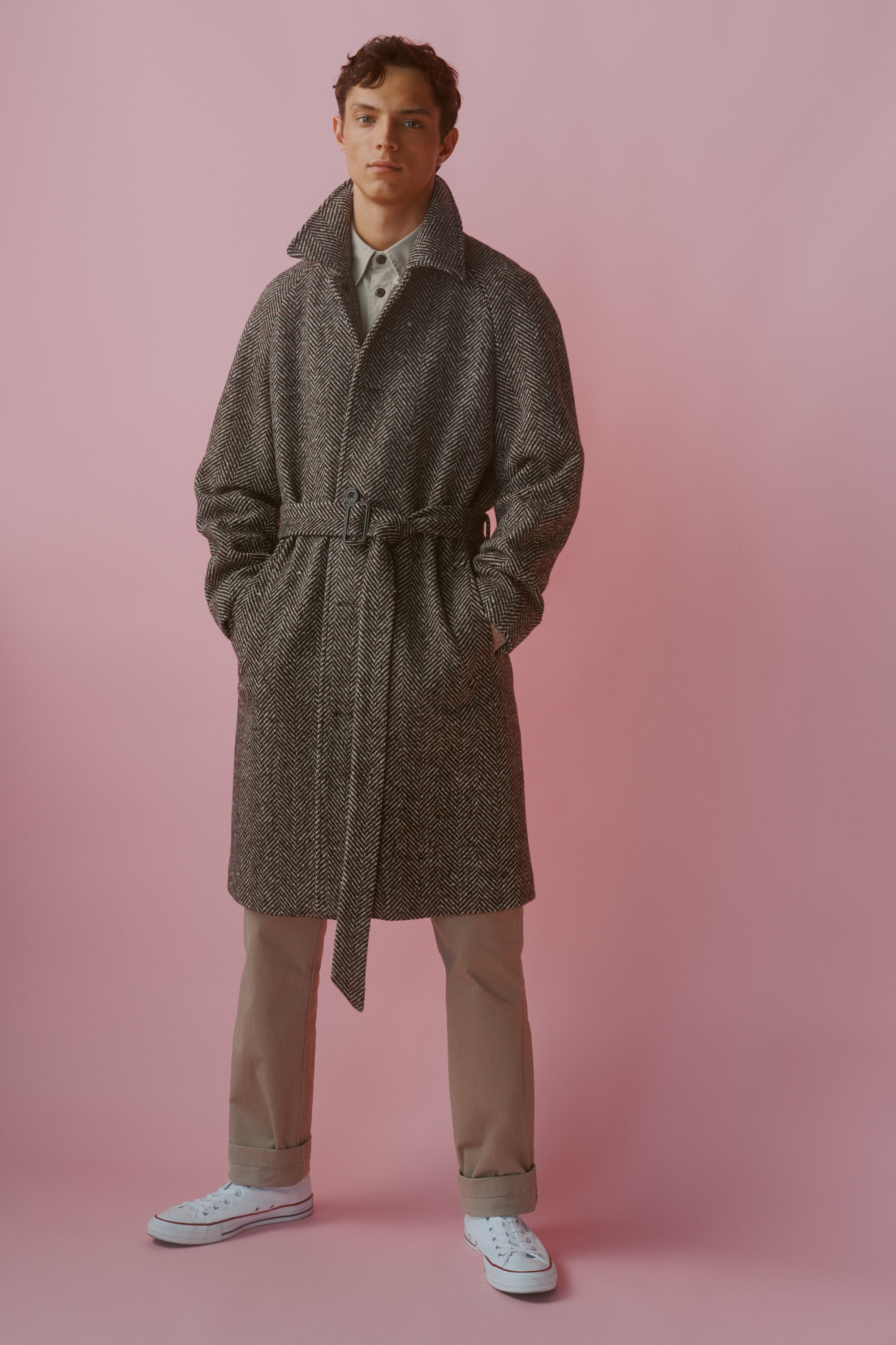 An Italian herringbone raglan coat, cotton twill overshirt,  straight fit essential chino and Converse high tops, all from John Lewis in Britain.