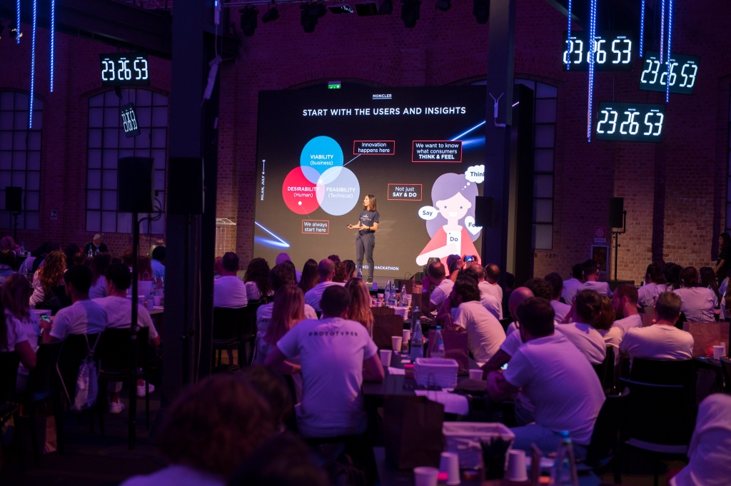 Moncler chief digital officer Paola Peretti on stage at the company's inaugural Hackathon in Milan.