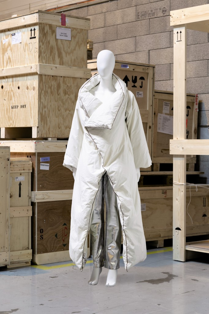 A long duvet coat from Maison Martin Margiela's fall 1999 collection with a pair of silver painted jeans.