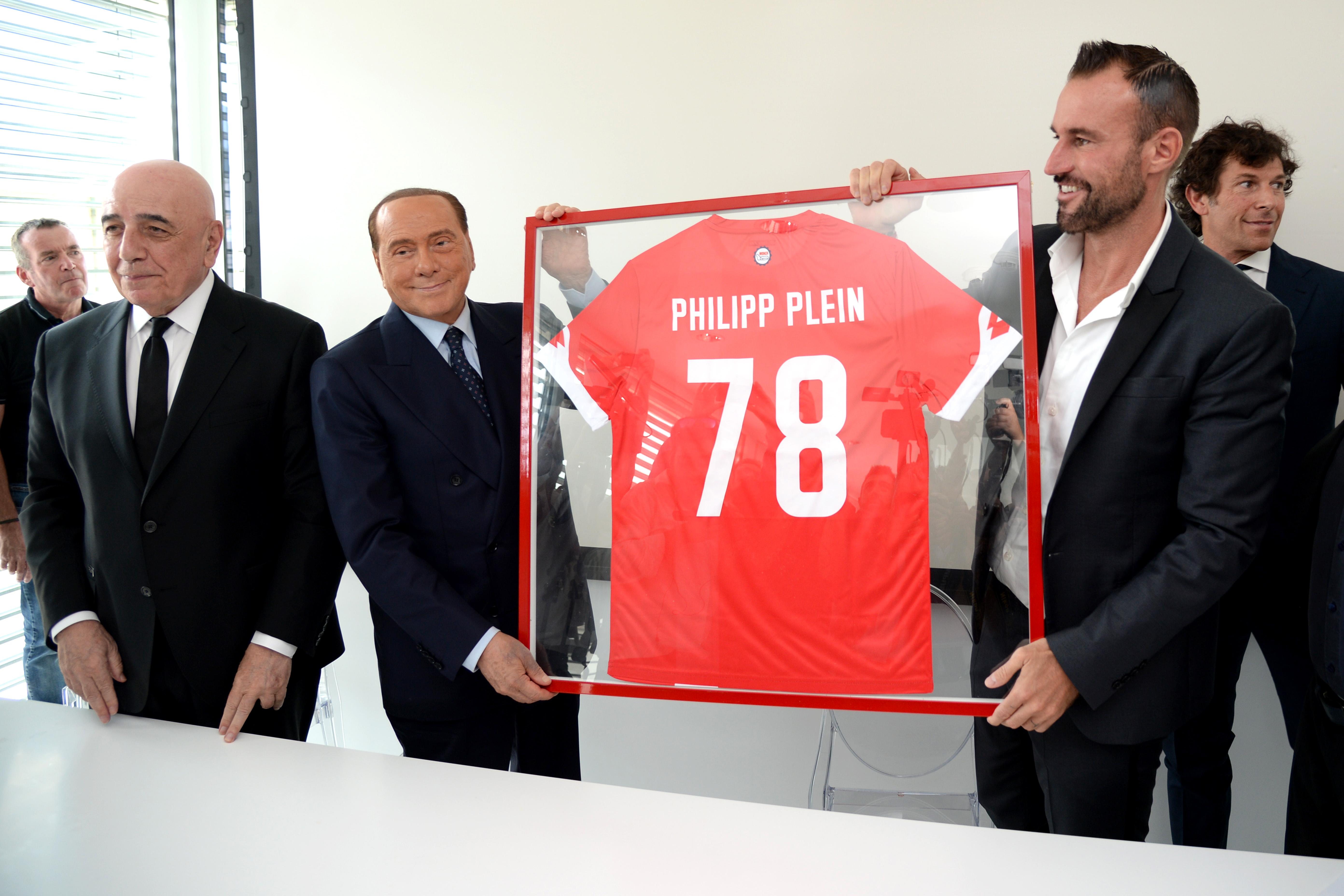 Philipp Plein and former Prime Minister Silvio Berlusconi during press conference