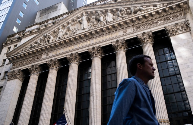 A person walks past the New York Stock Exchange in New York, New York, USA, on 07 May 2019. The Dow Jones industrial average lost 473 points today, and was down by as much as 600 points in interday trading, as markets continued to react to uncertainty surrounding trade negotiations between the United States and China.New York Stock Exchange, USA - 07 May 2019