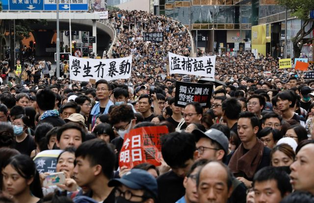 Protesters attend a rally on July 7 in Tsim Sha Tsui. The city has endured a month of protests and this most recent march moved to target Mainland Chinese hotspots.