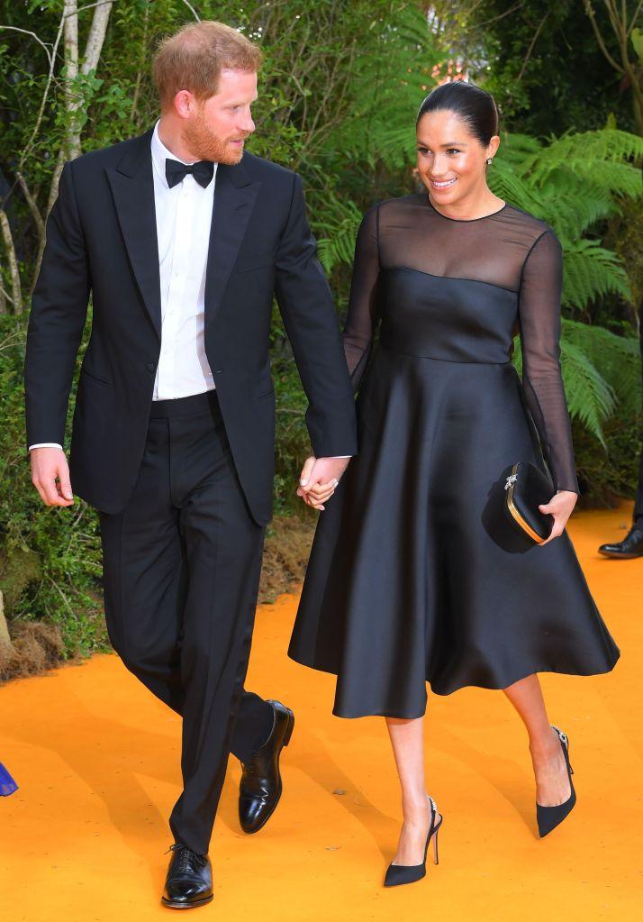 Prince Harry and Meghan Duchess of Sussex'The Lion King' film premiere, London, UK - 14 Jul 2019Wearing Jason Wu, Dress, Shoes By Aquazzura,Black Clutch Bag, Silk, Butterfly Clasp, Handbag, Purse, Satin, Bag By Gucci