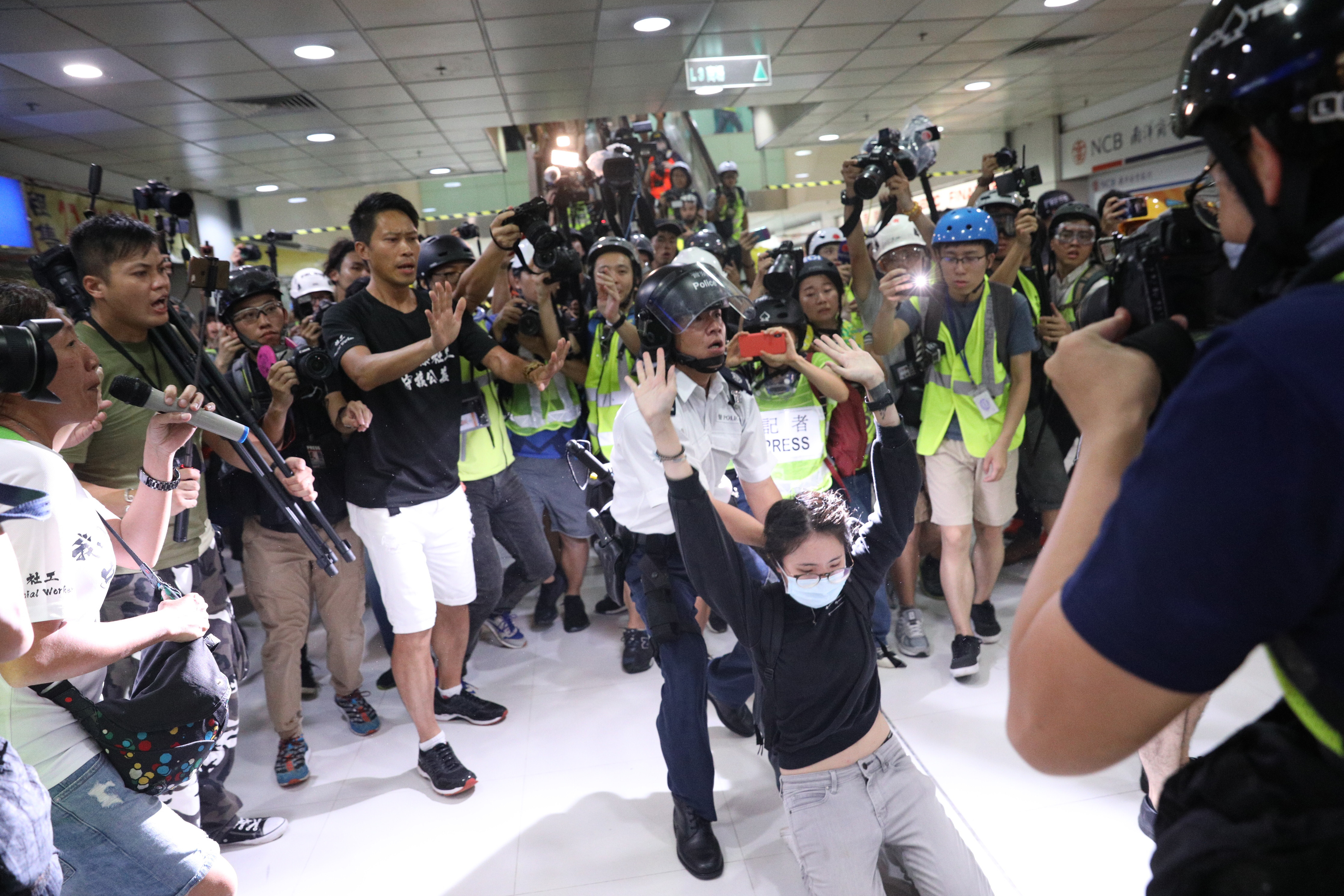 A woman is arrested by policeman while anti-extradition bill protesters march during a rally in Shatin, Hong Kong, China, 14 July 2019. Spurred by the momentum of the anti-extradition movement, the protesters are demanding the complete withdrawal of the extradition bill, which would have allowed the transfer of fugitives to mainland China, and unconditional release of all arrested protesters among other demands.Anti-extradition bill protesters rally in Shatin, Hong Kong, China - 14 Jul 2019