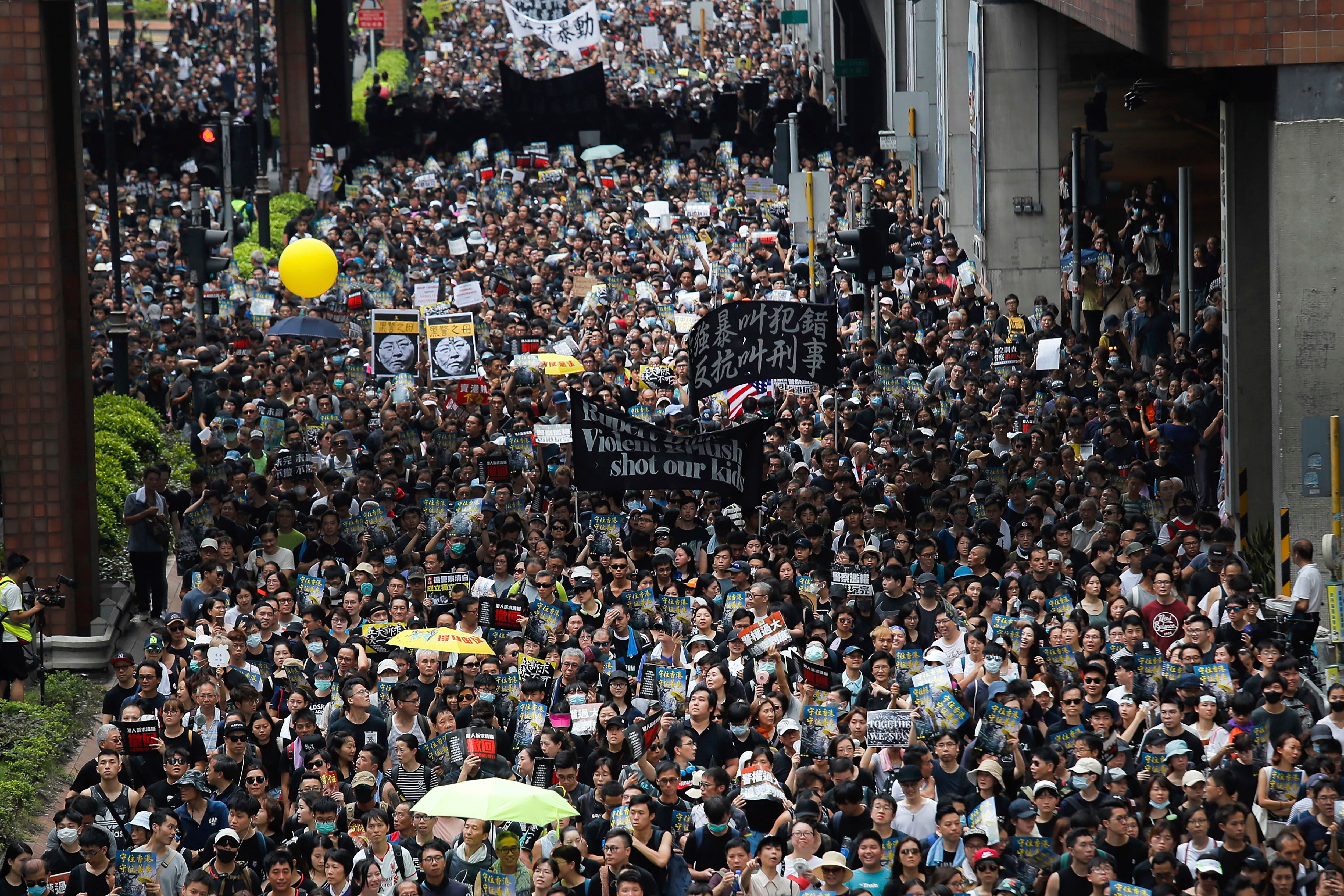 Protesters march through the Sha Tin District in Hong Kong, . Opponents of a proposed Hong Kong extradition law have begun a protest march, adding to an outpouring of complaints the territory's pro-Beijing government is eroding its freedoms and autonomyProtests, Hong Kong, Hong Kong - 14 Jul 2019