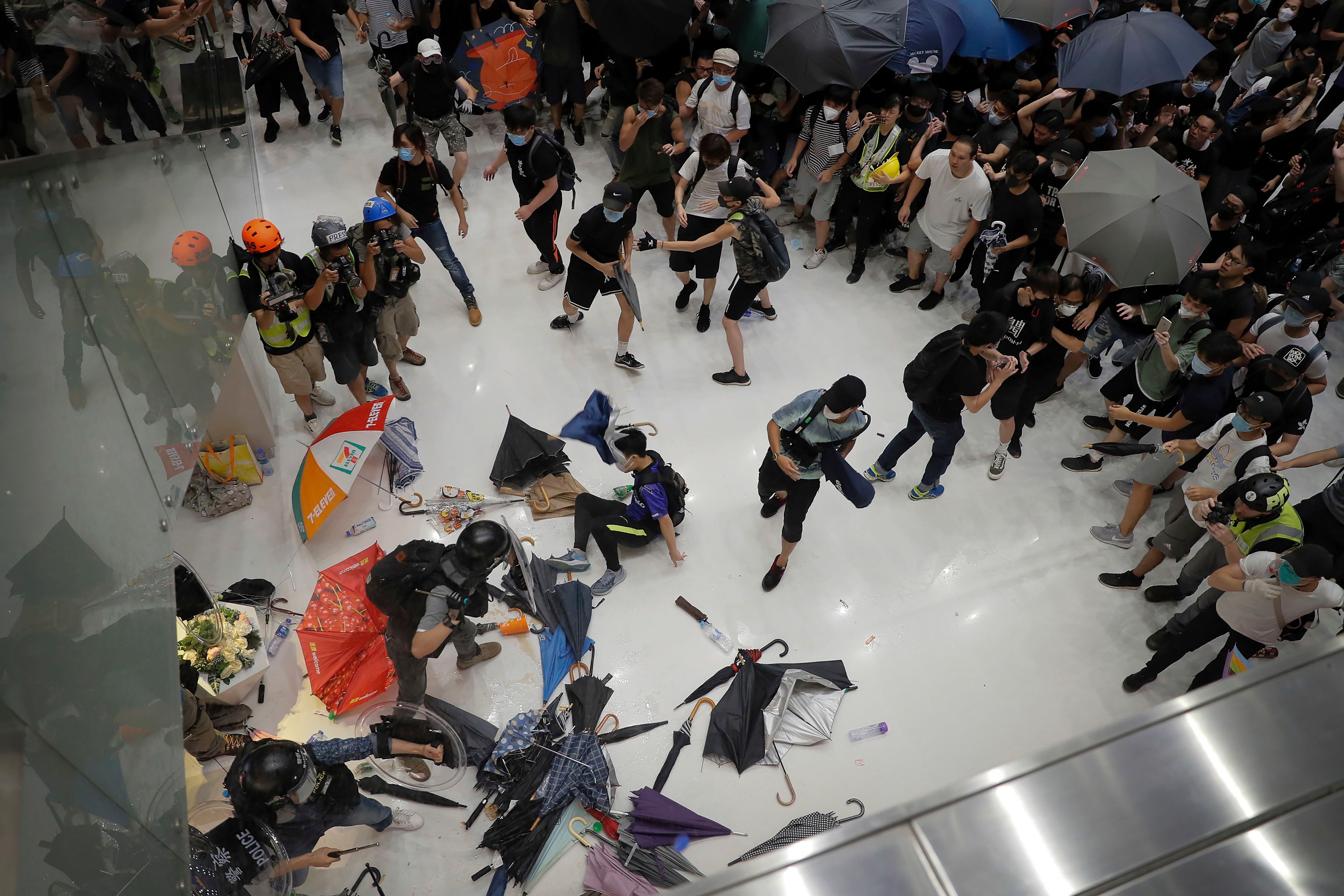 Policemen scuffle with protesters inside a shopping mall in Sha Tin District in Hong Kong, . Police in Hong Kong have fought with protesters as they broke up a demonstration by thousands of people demanding the resignation of the Chinese territory's chief executive and an investigation into complains of police violenceProtests, Hong Kong, Hong Kong - 14 Jul 2019