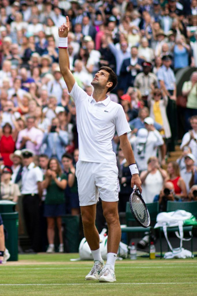 Novak Djokovic celebrates victory in his Men's Singles finalWimbledon Tennis Championships, Day 13, The All England Lawn Tennis and Croquet Club, London, UK - 14 Jul 2019