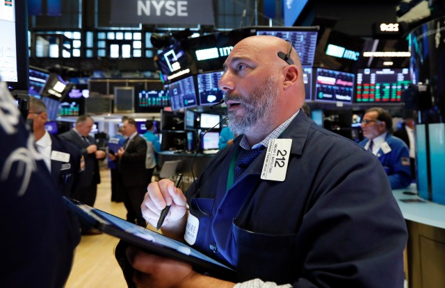 Trader Vincent Napolitano works on the floor of the New York Stock Exchange, . U.S. stocks moved higher in early trading Monday on Wall Street as investors snapped up technology stocksFinancial Markets Wall Street, New York, USA - 22 Jul 2019