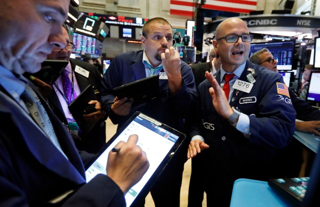 Specialist Mario Picone, right, works with traders at his post on the floor of the New York Stock Exchange, . U.S. stocks moved broadly lower in early trading on Wall Street Tuesday as President Donald Trump ramped up criticism of China just as negotiators began a new round of trade talksFinancial Markets Wall Street, New York, USA - 30 Jul 2019