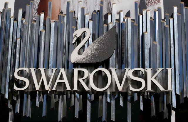 """The logo of """"Swarovski"""", Austrian producer of crystal Business, that primarily produces crystal jewelry and accessories and optical instruments such as telescopes and binoculars is pictured on the Champs Elysees Avenue in Paris, FranceSwarovski, Paris, France - 20 Sep 2017"""