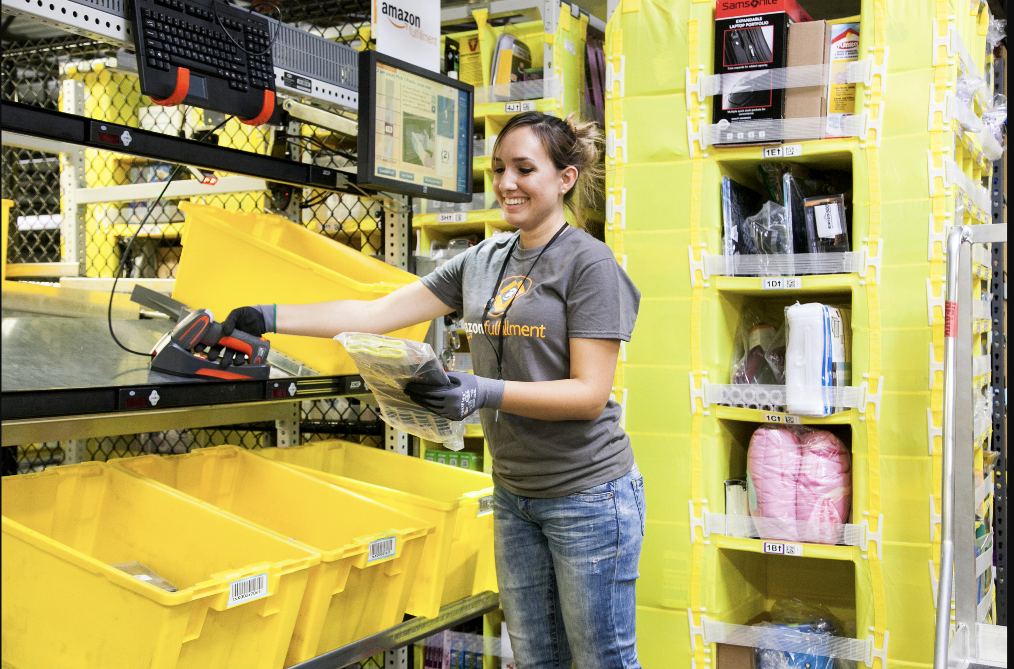 An employee picking at an Amazon fulfillment center.