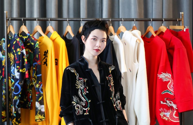 Designer Angel Chen with her H&M capsule collection.
