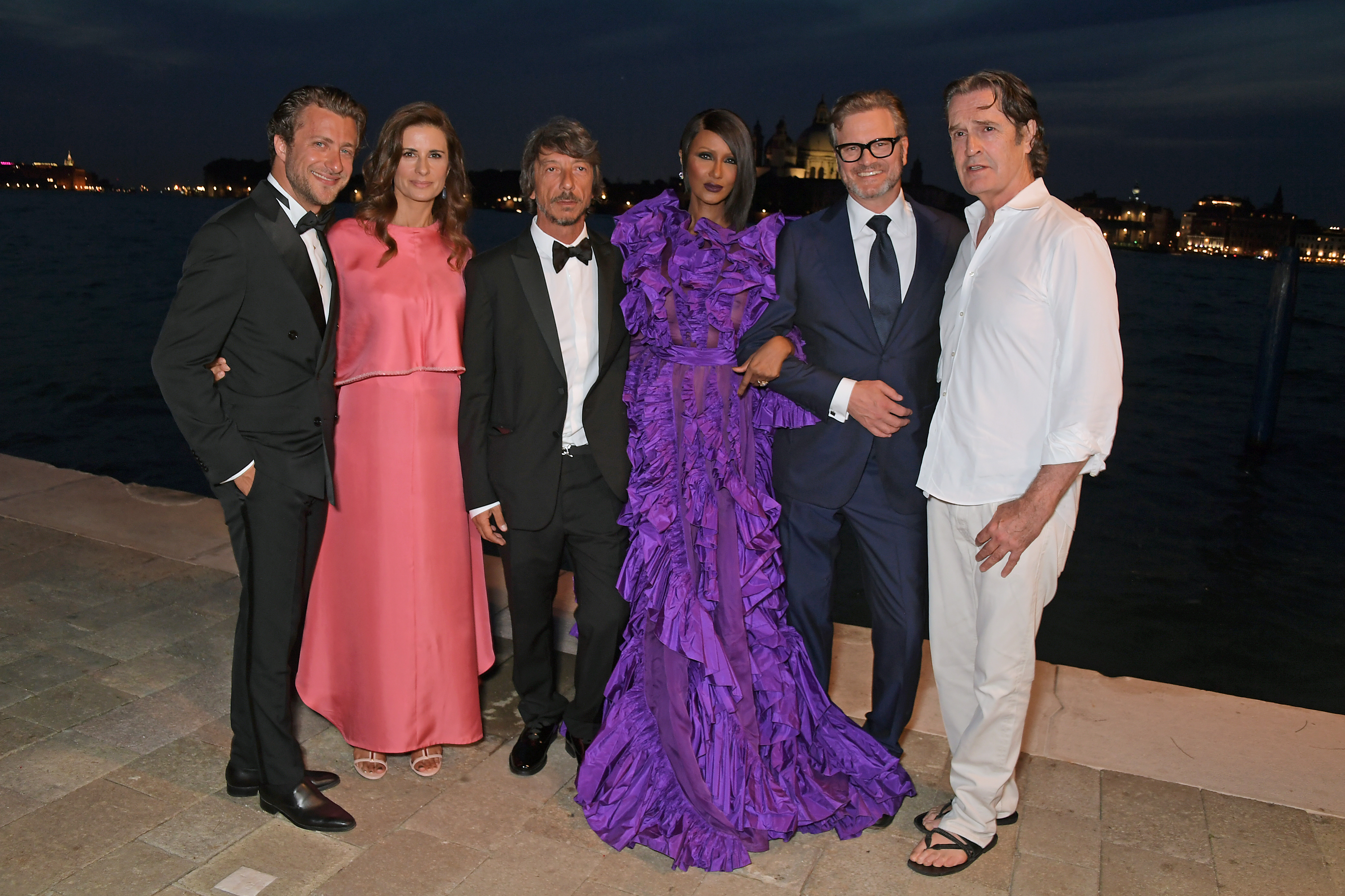 VENICE, ITALY - AUGUST 27: (L to R) Francesco Carrozzini, Livia Firth, Pierpaolo Piccioli, Iman, Colin Firth and Rupert Everett attend the third Franca Sozzani Award 2019 at the Belmond Cipriani Hotel on August 27, 2019 in Venice, Italy.  (Photo by David M. Benett/Dave Benett/Getty Images for Eco-Age)