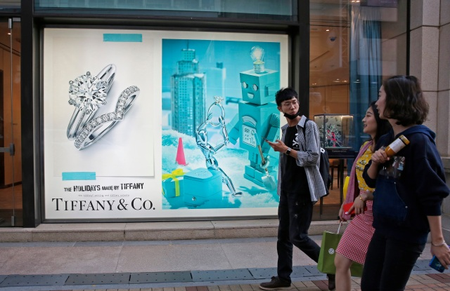 Chinese tourists walk past a Tiffany & Co. flagship in Canton Road, the one-stop-shop high street of high-end brands in Hong Kong. The designer boutiques of Manhattan and Paris are feeling the chill of a Chinese economic slowdown that has hammered automakers and other industries. That is jolting brands such as Louis Vuitton and Burberry that increasingly rely on Chinese customers who spend $90 billion a year on jewelry, clothes and other high-end goods. The industry already is facing pressure to keep up as China's big spenders shift to buying more at the spreading networks of luxury outlets in their own countryChina Luxury Shopping Chill, Hong Kong, Hong Kong - 29 Nov 2018