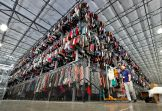 """Thousands of garments are stored on a three-tiered conveyor system at the ThredUp sorting facility in Phoenix. Charitable organizations like Goodwill have cited how Marie Kondo's popular Netflix series, """"Tidying up with Marie Kondo"""" has led to a surge of donations. And sites like OfferUp and thredUP also note an uptick in the number of items being sent to them for saleOn The Money Decluttering Tips, Phoenix, USA - 10 Mar 2019"""