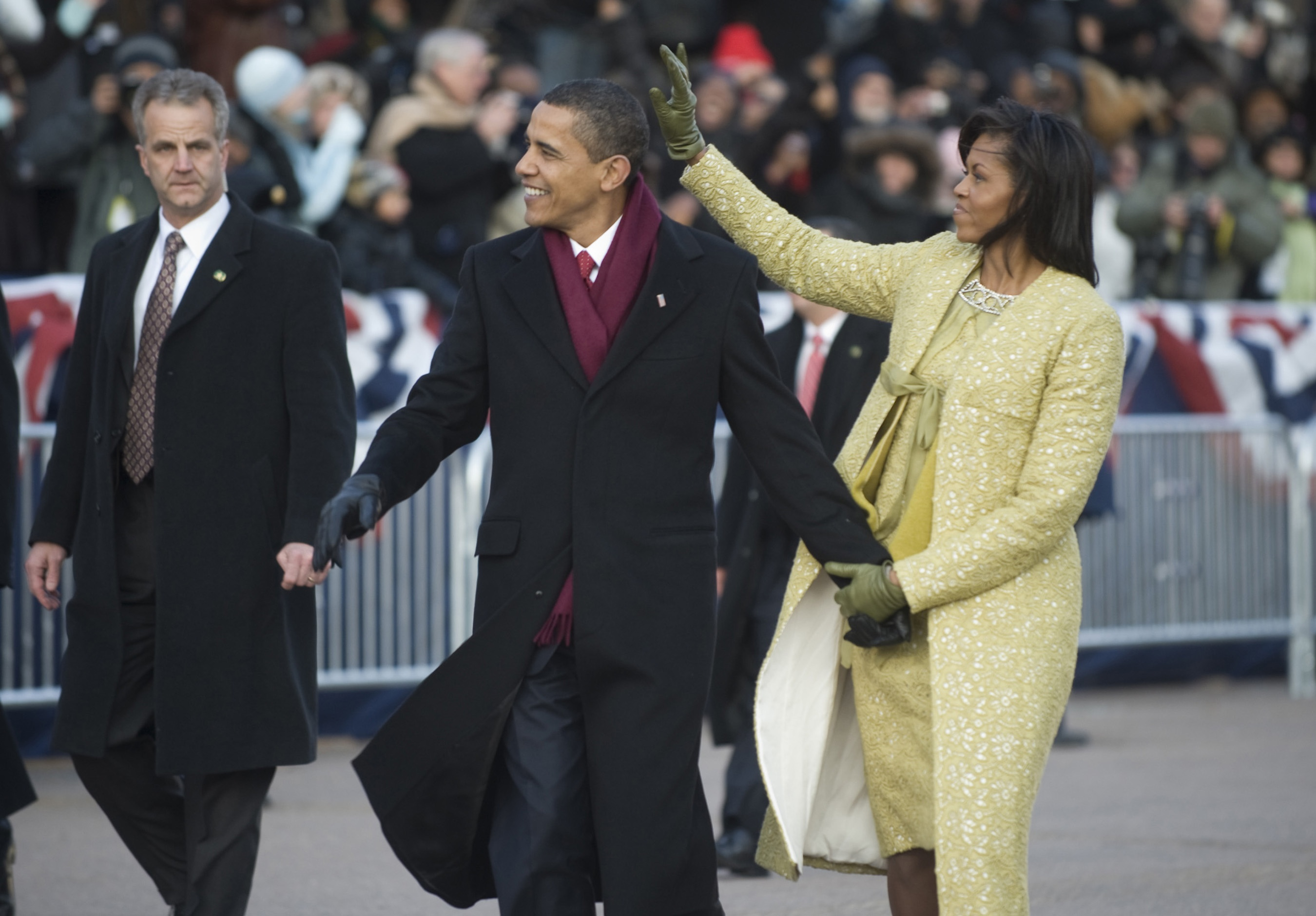 President and Michelle Obama wave to the crowd along Pennsylvania Avenue during the 2009 presidential inaugural parade. Jan. 20 2009. Michelle wears a lemongrass suit by Isabel Toledo a vintage antique paste pin and Crew leather gloves.Historical Collection