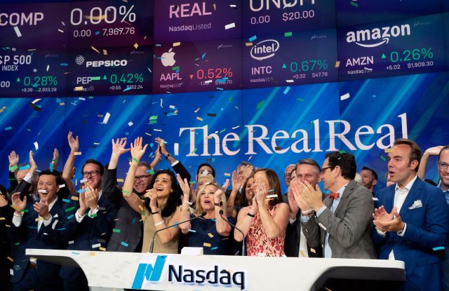 Julie Wainwright, center, CEO of The RealReal, celebrates her company's IPO at the Nasdaq opening bell, in New York. The online reseller of luxury brand clothing and accessories is based in San FranciscoFinancial Markets RealReal IPO, New York, USA - 28 Jun 2019