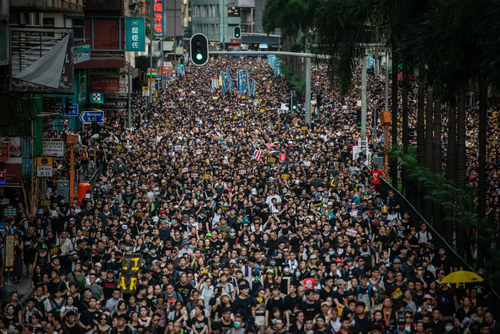Demonstrators march during Civil Human Rights Front march in Wan Chai Anti Extradition Bill protest, Hong Kong