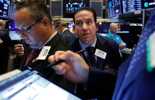 Trader Tommy Kalikas, center, works on the floor of the New York Stock Exchange. Stocks took a nosedive and bond prices spiked after President Donald Trump said the U.S. would raise tariffs on more Chinese goods, increasing the stakes in an ongoing trade battle. The market had been on track for its biggest gain in nearly two months Thursday, Aug. 1Financial Markets Wall Street, New York, USA - 31 Jul 2019