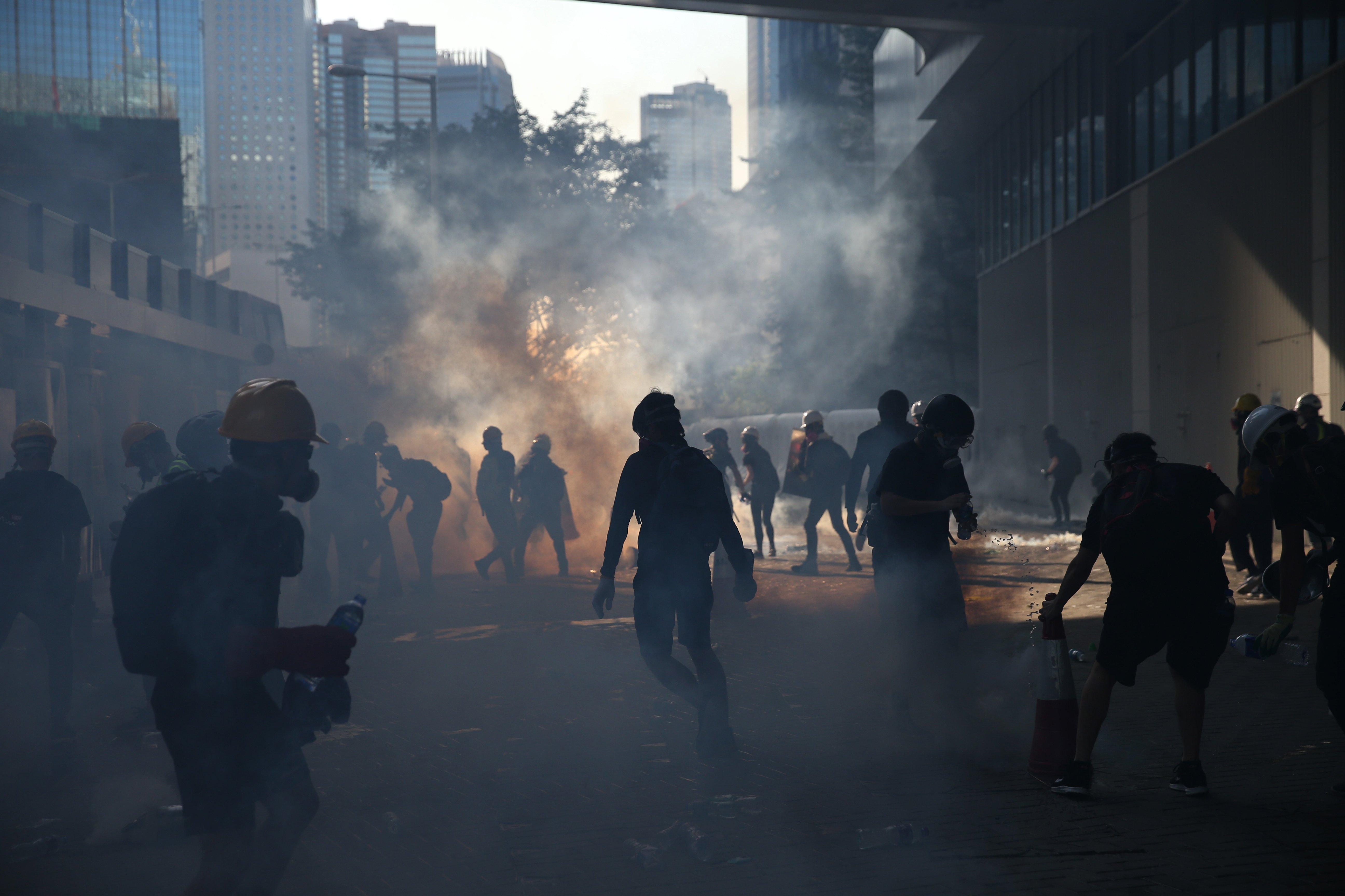 Anti-extradition protesters react after police fired tear gas at them in the Admiralty area of Hong Kong, China.