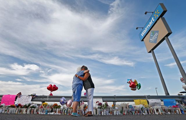 Emma Del Valle (L) hugs Brenda Castaneda (R) while attending the make shift memorial along the street after the mass shooting that happened at a Walmart in El Paso, Texas, USA, 05 August 2019. Twenty people killed and forty injured from the mass shooting at the Walmart in El Paso, Texas, on 03 August 2019.Mass shooting at Wal-Mart in El Paso, Texas, USA - 05 Aug 2019