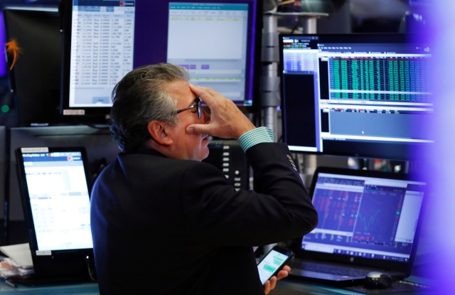 Trader John Bishop works on the floor of the New York Stock Exchange, . Stocks are plunging on Wall Street Monday on worries about how much President Donald Trump's escalating trade war with China will damage the economyFinancial Markets Wall Street, New York, USA - 05 Aug 2019