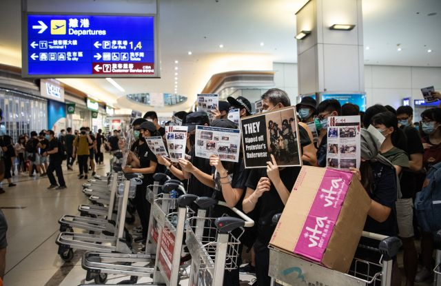 Protesters block the departures area in Hong Kong International Airport.