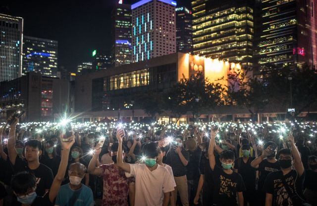 Students wave their phone at a protest in Hong Kong on Thursday, August 22, 2019.