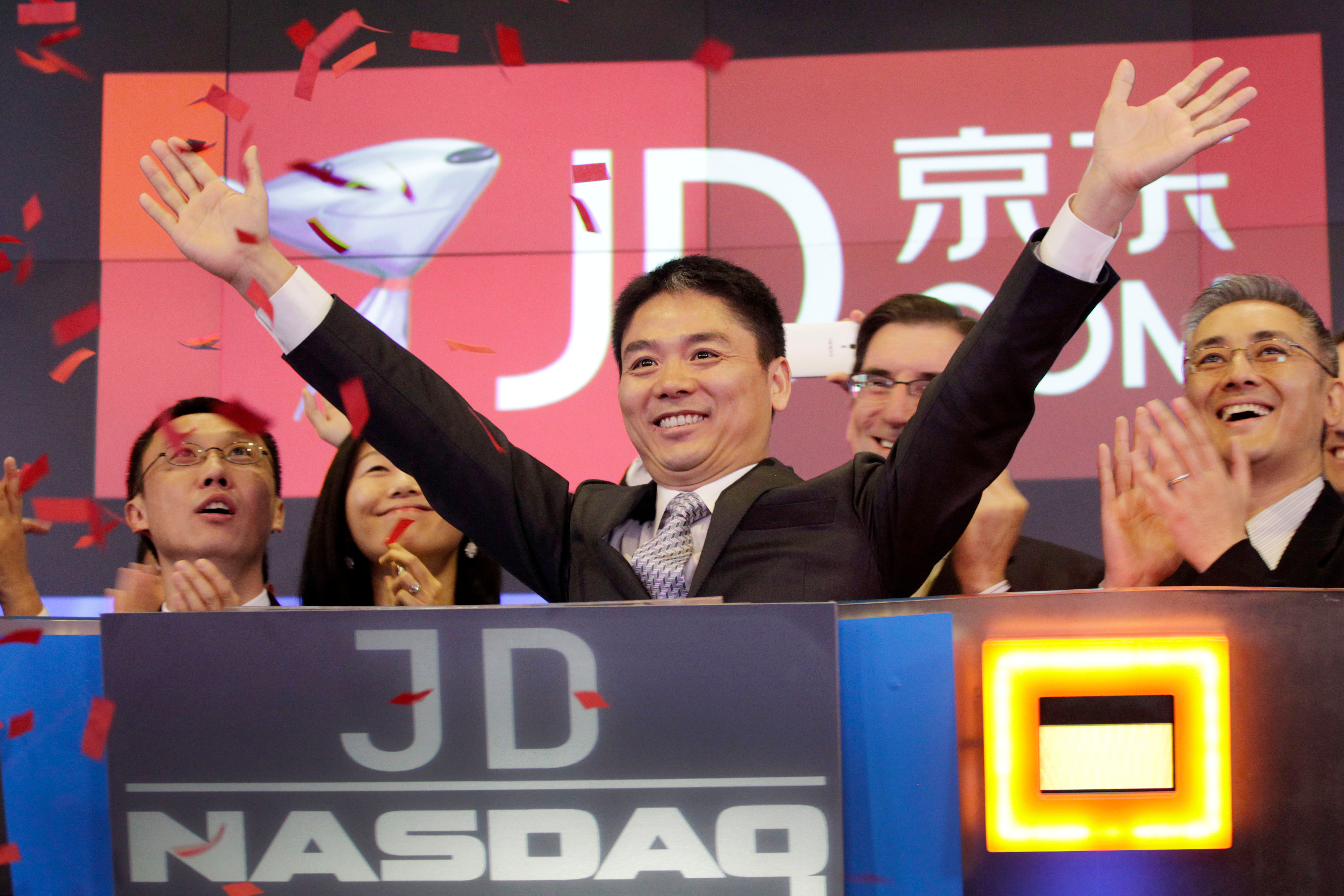 Richard Liu, CEO of JD.com, raises his arms to celebrate the IPO of his company in New York.