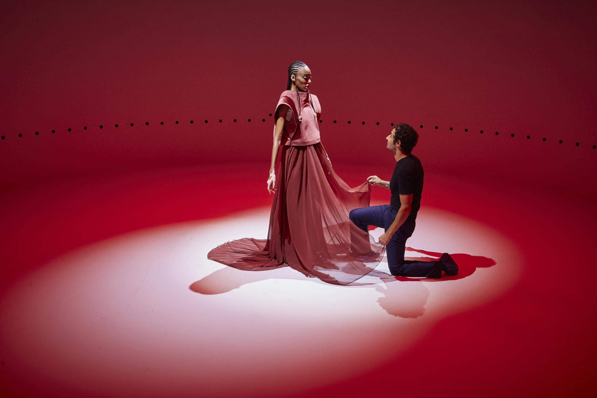 Inside the drum, Zac Posen plays Prince Charming to Winnie HarlowÕs Galactic Princess.
