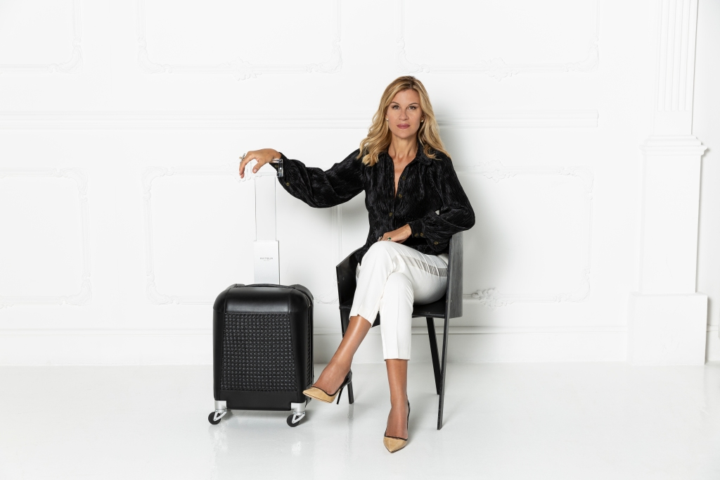Patricia Gucci with an Aviteur carry-on.