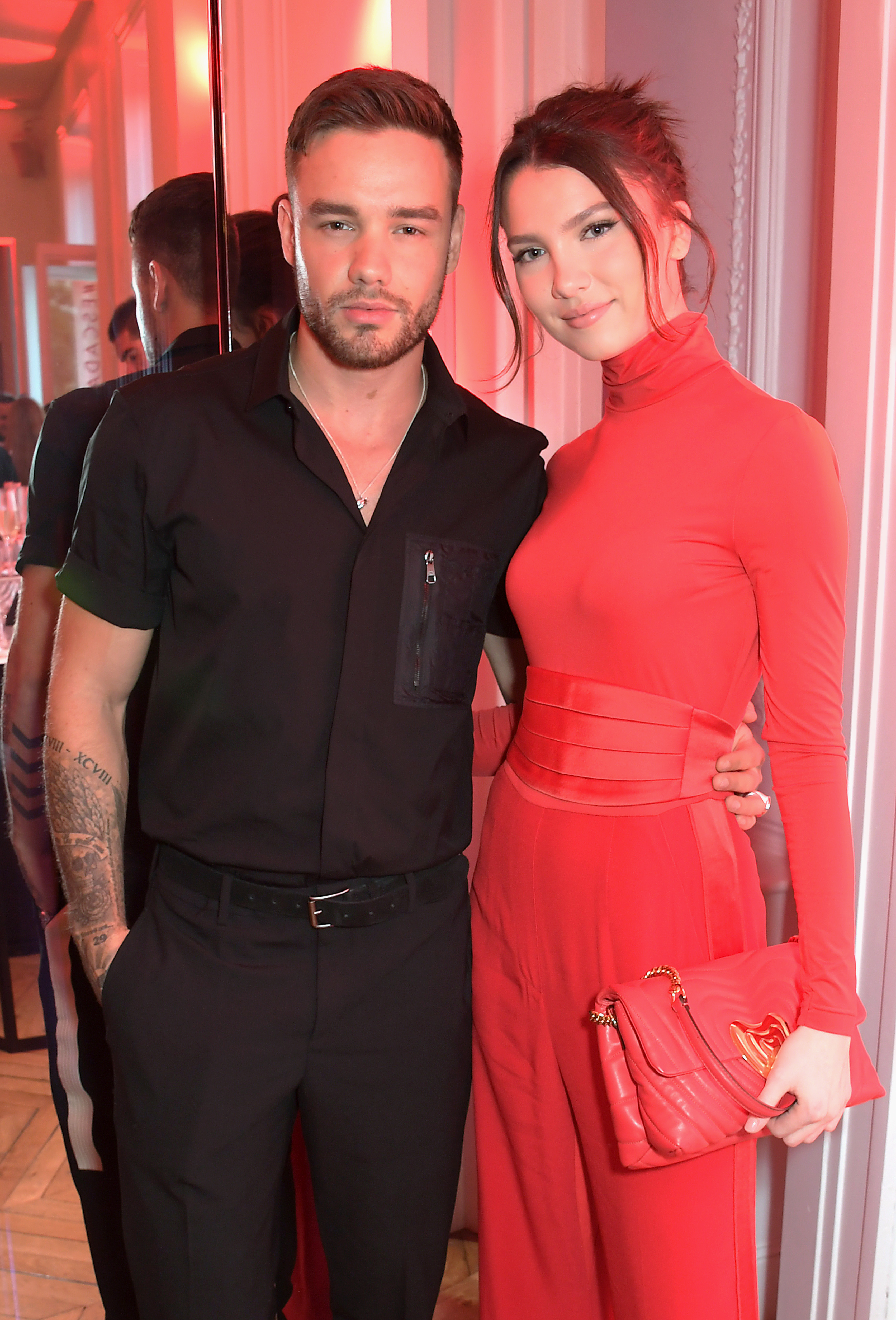 Liam Payne and Maya Henry at the ESCADA x RITA ORA capsule launch event during Paris Fashion Week.