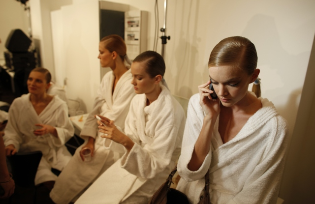 Models backstage at Gucci's spring 2010 runway show.