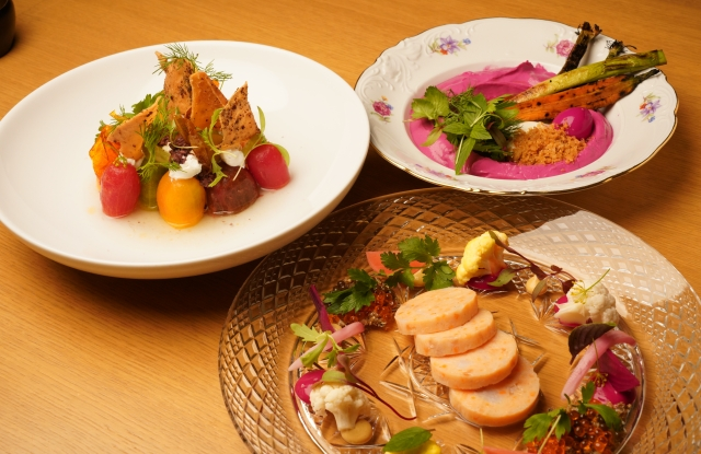 Clockwise from top left, fatoush salad, beet hummus, and gefilte fish.