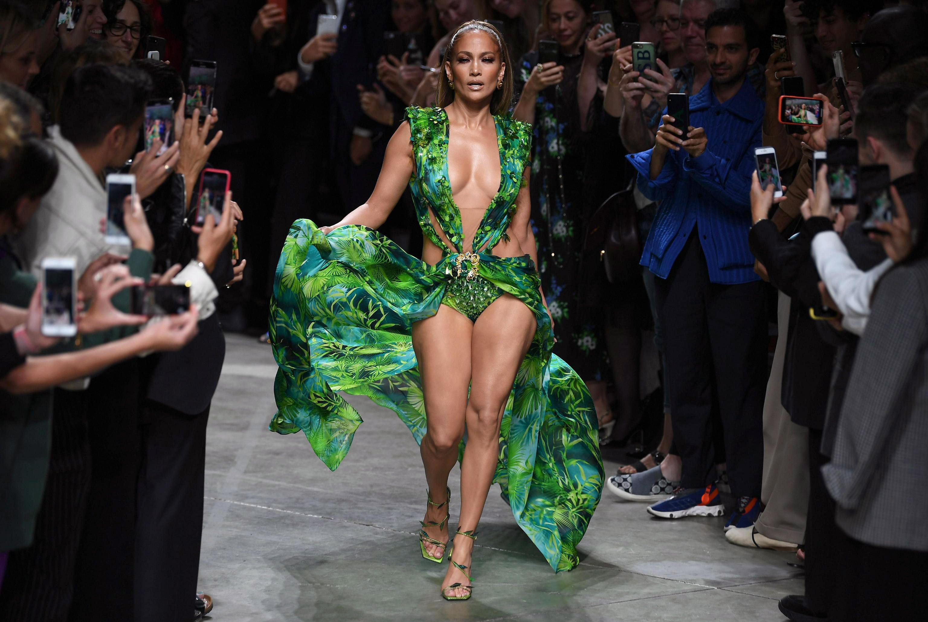 US actress Jennifer Lopez presents a creation by Versace during the Milan Fashion Week, in Milan, Italy, 20 September 2019. Spring-Summer 2020 women's collections are presented at the Milano Moda Donna from 17 to 23 September.Versace - Runway - Milan Fashion Week S/S 2020, Italy - 20 Sep 2019