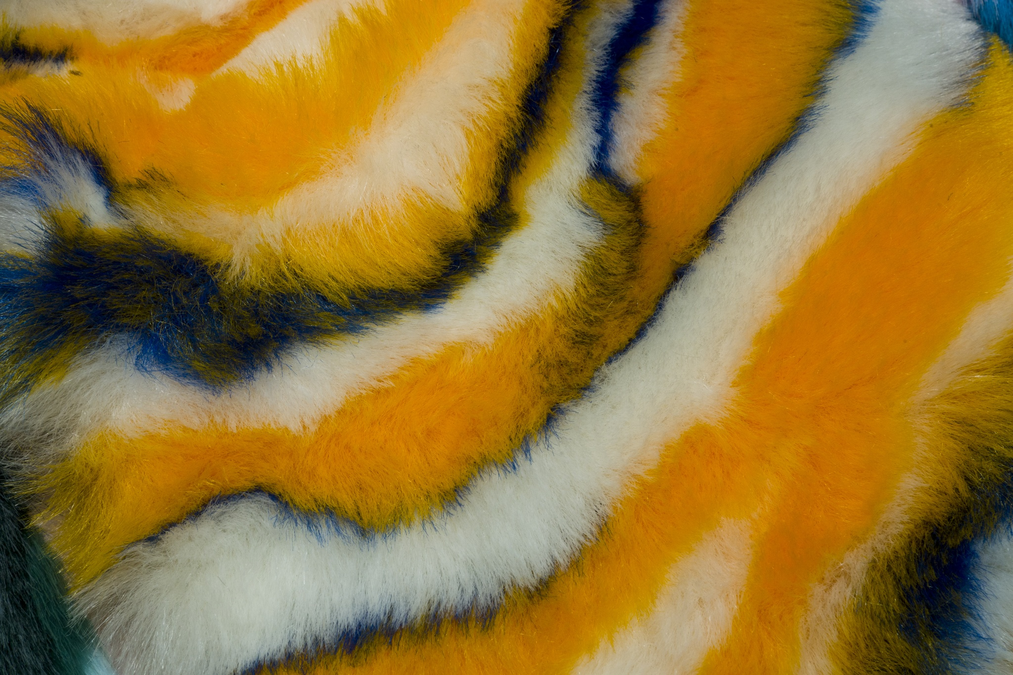 A faux fur in a twisted animal print by Jules Tournier Since 1865.