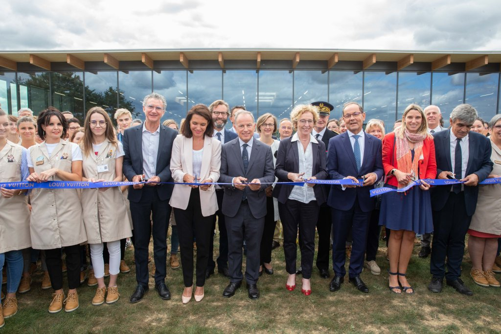 Michael Burke, Muriel Pénicaud and local officials cut the ribbon on the Louis Vuitton workshop in Beaulieu-sur-Layon.