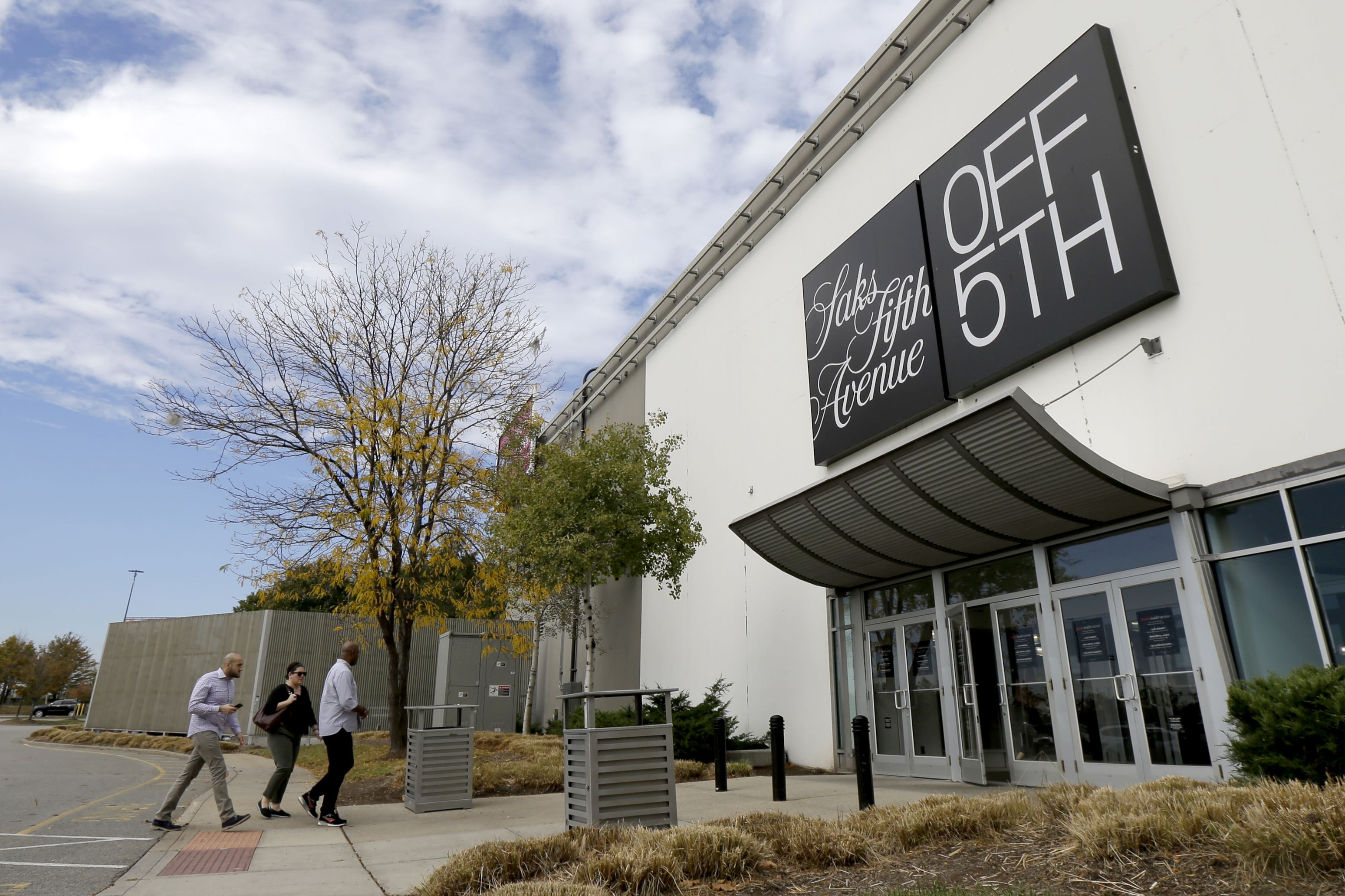 Shoppers walk toward a Saks Fifth Avenue OFF 5TH department store at Jersey Gardens Mall, in Elizabeth, N.JNew Jersey Retailer Stores, Elizabeth, USA - 25 Oct 2017