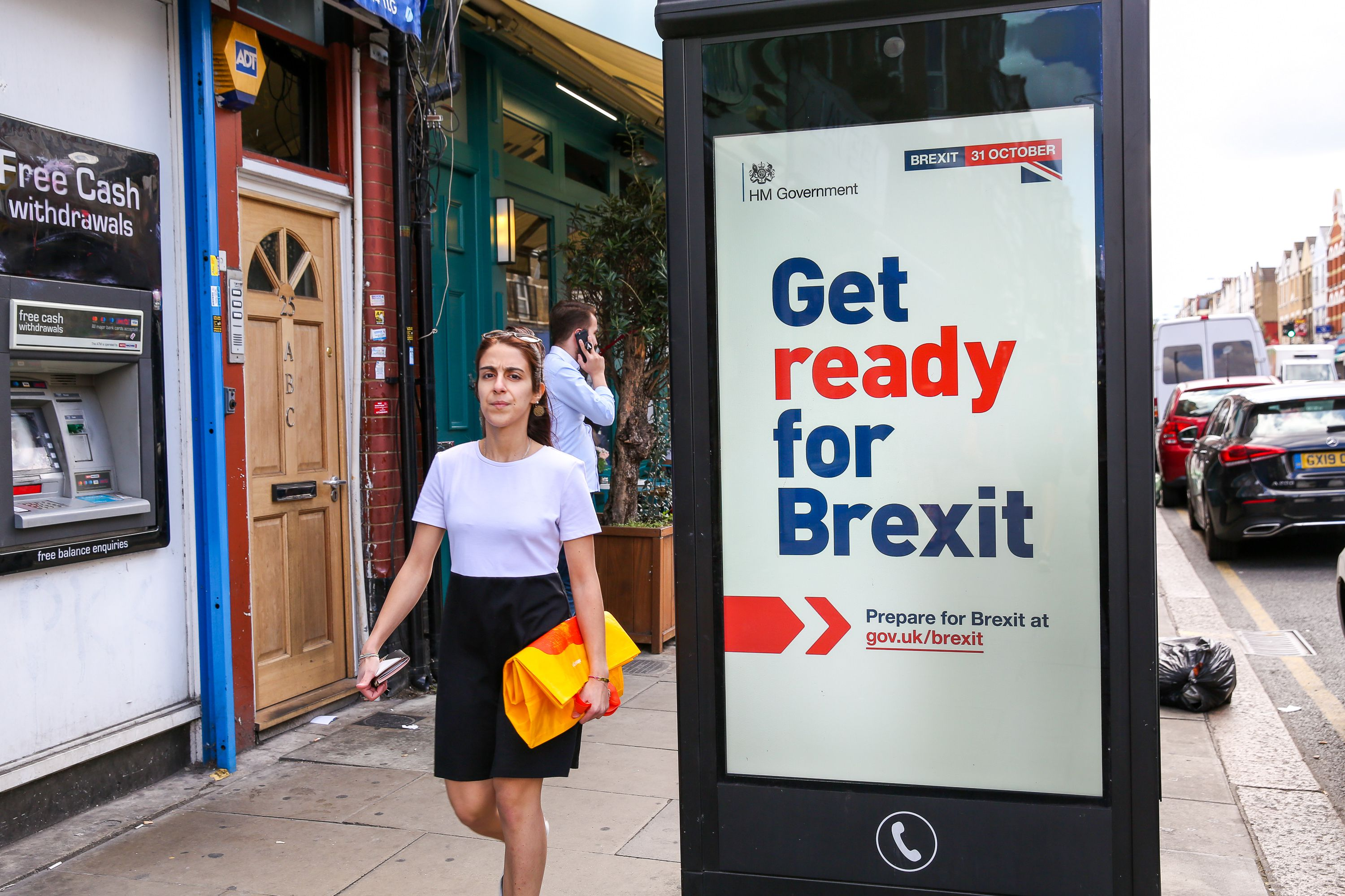 """A woman walks past the new 'Get ready for Brexit' advert on a telephone box in north London. Today, the UK Government launches its £100m """"Prepare for Brexit"""" advertising campaign to reassure the nation ahead of a potential no-deal departure from the European Union on 31 October.Government's £100m Brexit campaign, London, UK - 01 Sep 2019"""