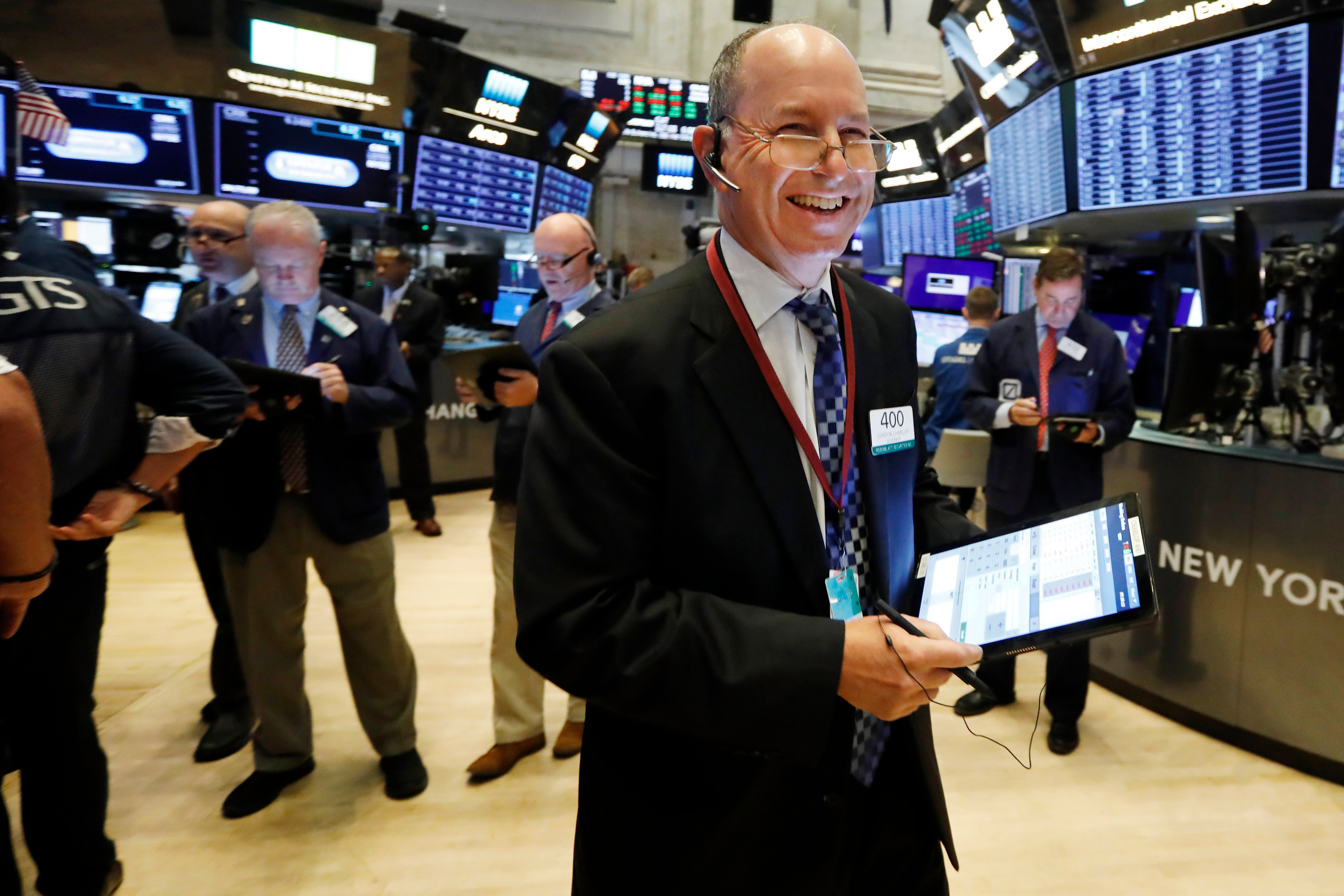 Trader Gordon Charlop smiles as he works on the floor of the New York Stock Exchange, . Stocks are opening higher on Wall Street following big gains in Asia as Hong Kong's government withdrew a controversial extradition law that set off three months of protests thereFinancial Markets Wall Street, New York, USA - 04 Sep 2019