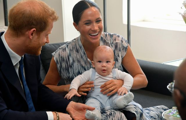 Prince Harry and Meghan Duchess of Sussex, holding their son Archie Harrison Mountbatten-Windsor at the Desmond & Leah Tutu Legacy Foundation in Cape Town, South Africa