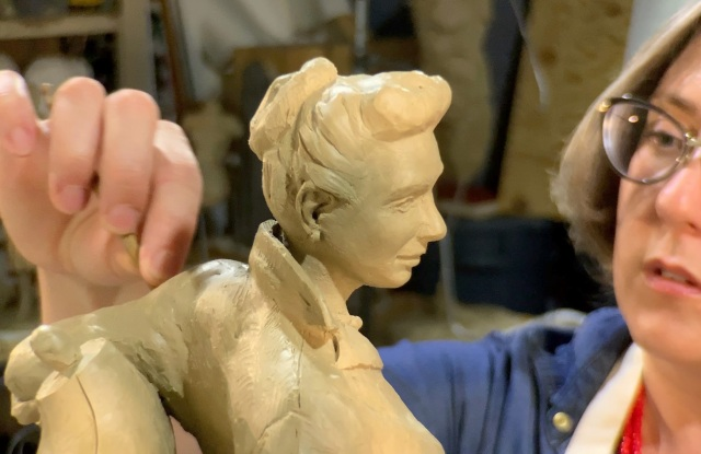 Sculptor Sarah Hempel Irani works on a scale model of Claire McCardell.