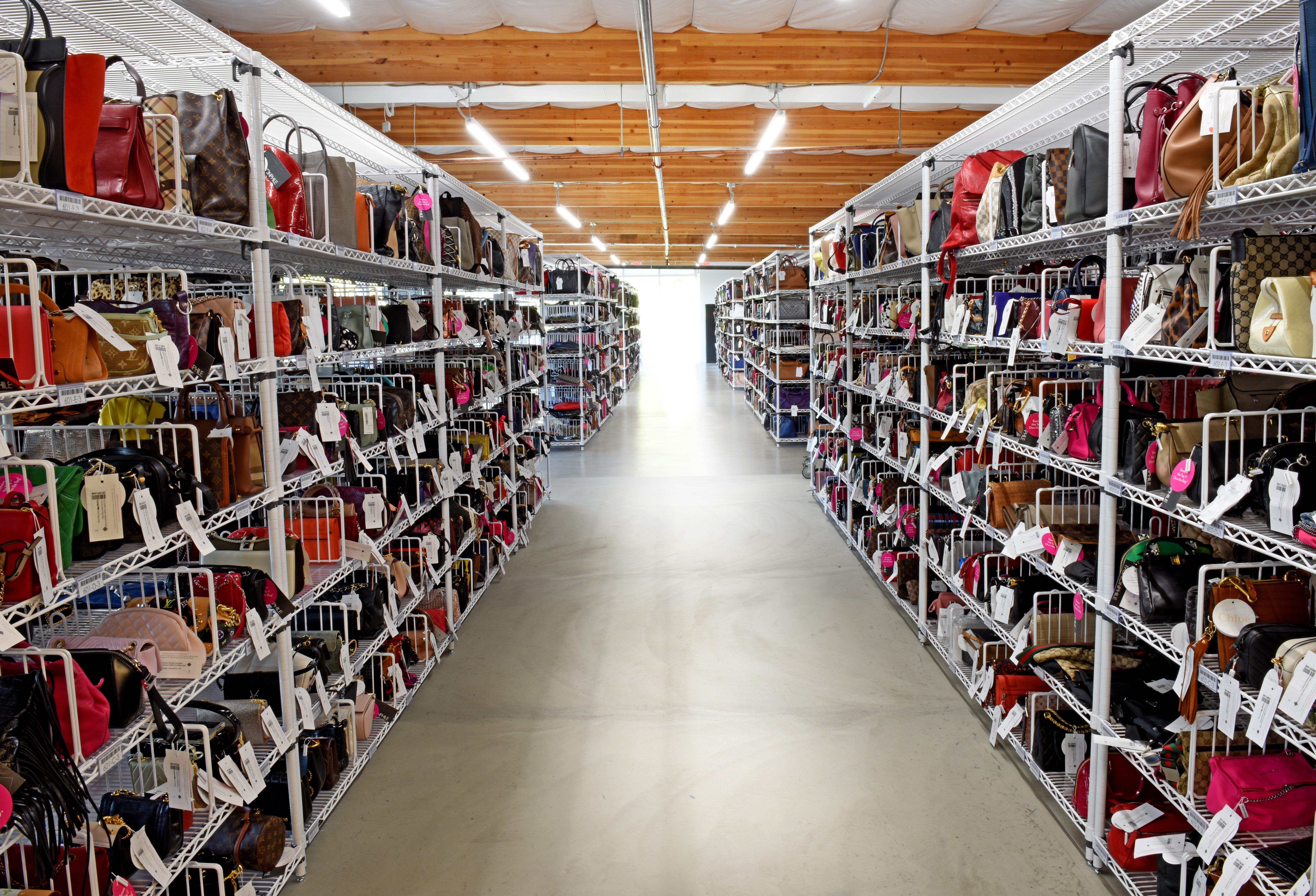 Fashionphile's Carlsbad headquarters with handbags as far as the eye can see. The new Moonachie, N.J. facility will have a similar layout.