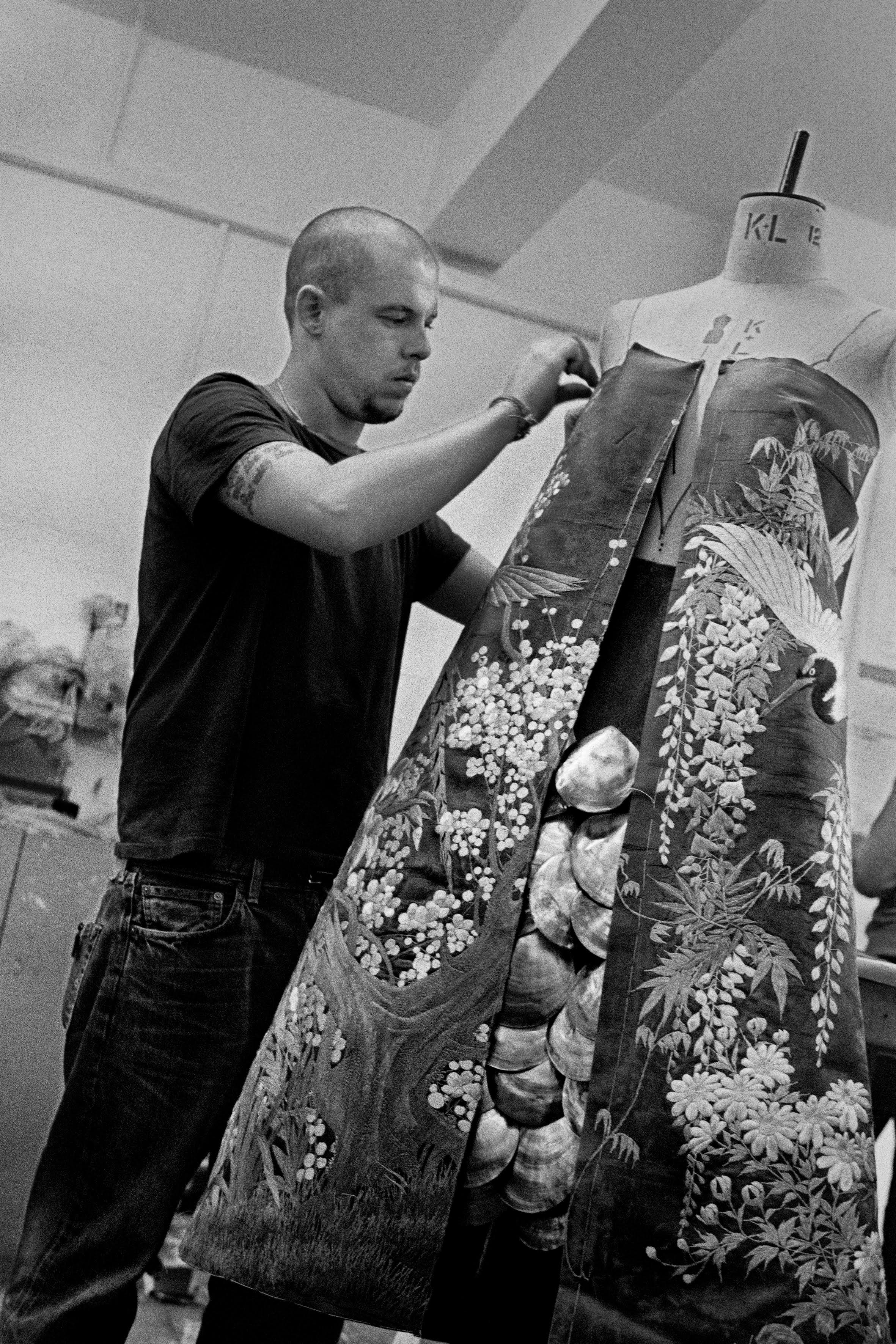 McQueen working on the shell dress, which appeared in the Voss show.